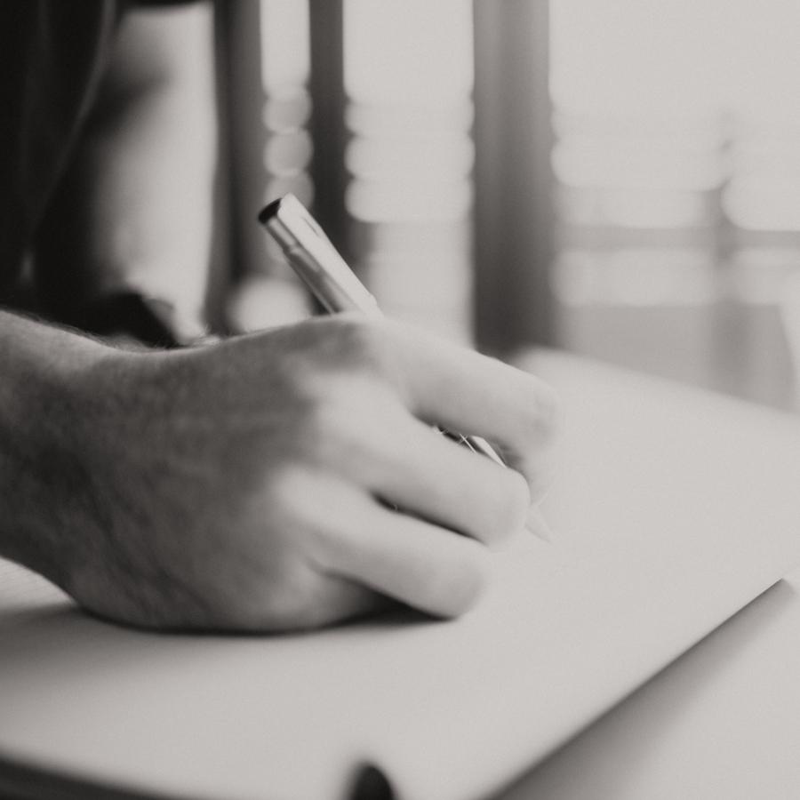 A Wealthvisory employee writing down accounting computations.
